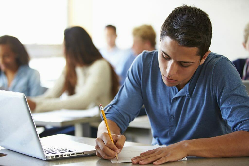 High School Students Taking Test In Classroom